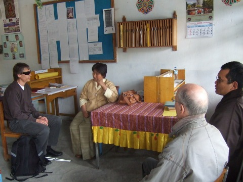 [Photo: Magne, Nils and Pema talking to Tshering Yedon]