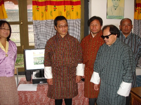 [Photo: Tshering, Pema, Kuenga and others proudly demonstrate NIVI's home page]